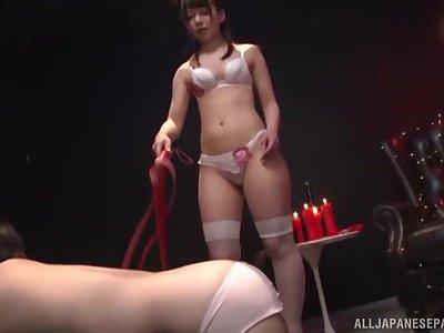Japanese kinky nurse Arimura Nozomi sucks cock on her knees