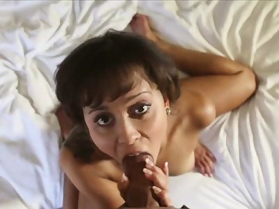 She smiles while milking and riding a heavy dick